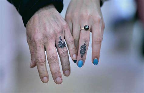 intimate  interwoven snake tattoos  mirko sata