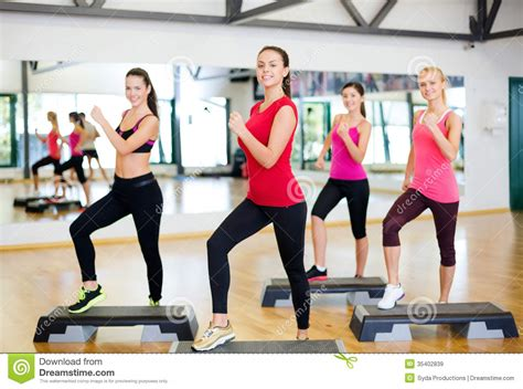Group Of Smiling People Doing Aerobics Stock Image