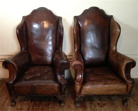 an pair of leather wing chairs c 1900