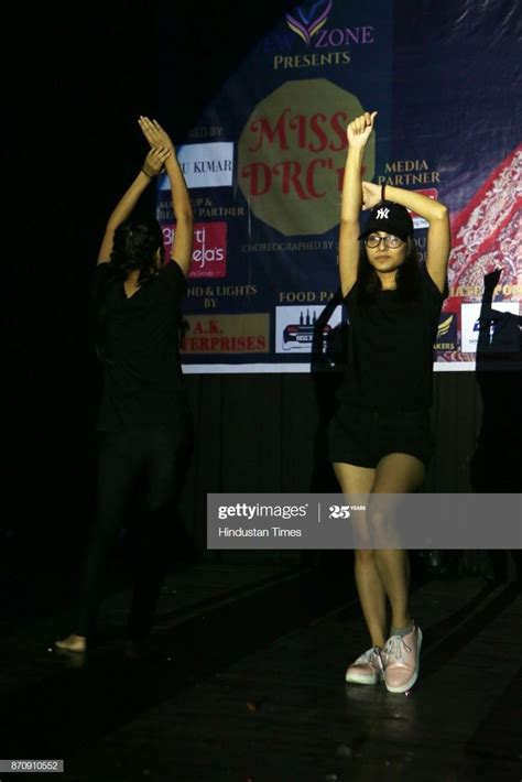 A student participates during an annual freshers party ...