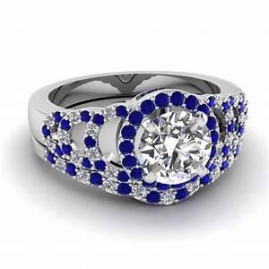 Awesome diamond and blue sapphire wedding sets for Blue sapphire wedding ring set