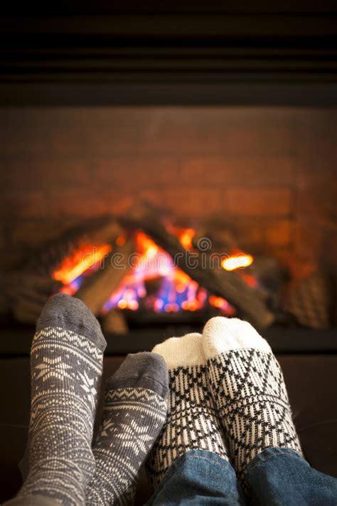 feet warming  fireplace stock image image  people