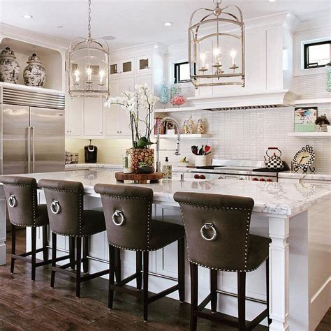 white kitchen island with stools classic barstools enhance this traditional kitchen 18 1823