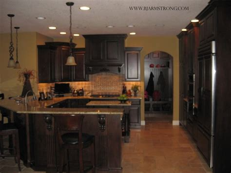how to hang a kitchen cabinet custom walnut kitchen with granite countertops 8669