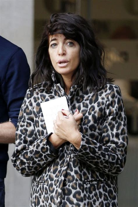 Claudia Winkleman looks bleary-eyed as she steps out in ...