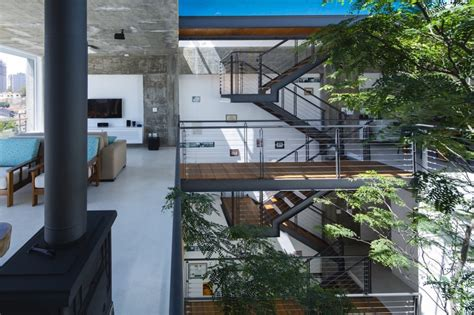 Beautiful Brazilian House Built Up And Around A Tree : Three-story Courtyard House