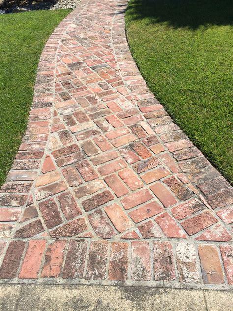 brick pathways herringbone brick pathway with border on concrete pathways patios pinterest herringbone