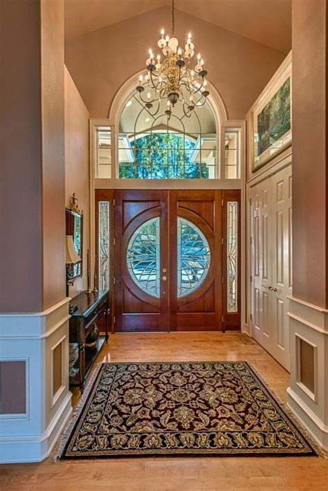 beautiful grand entryway complete  chandelier