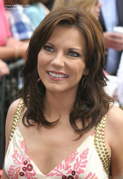 Martina McBride's long hair with layers and styled around