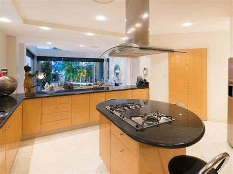 oval kitchen island  black countertop kitchen lighting
