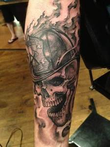 Black Ink Firefighter Skull Tattoo Design For Forearm