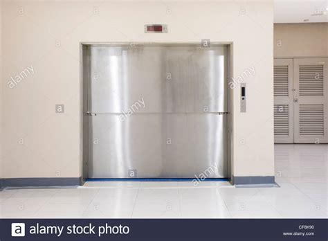 Two Section Slide-up Door Of Freight Elevators In Modern