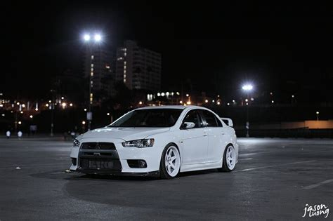 white mitsubishi lancer with black rims white mitsubishi lancer evo x on white wheels rice