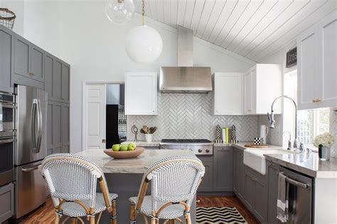The type of cabinets you see here is from rift white oak. Under a sloped shiplap ceiling, this gorgeous white and ...