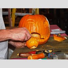 Halloween Pumpkin Carving A Large Pumpkin Eating A Small