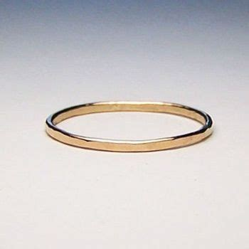 the thought of a simple gold wedding band is very appealing although i still the tradition