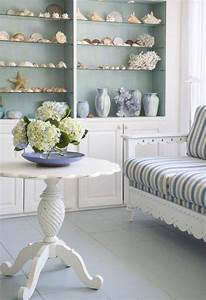 Bring the shore into home with beach style living room for Beach themed living room decorating