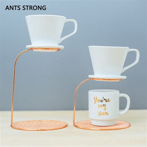 Touch essential™ single serve coffee brewer in black. ANTS STRONG Rose gold coffee dripper stand/household hand coffee filter cup holder supporting ...