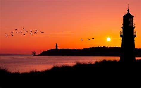 wallpaper  flock  birds lighthouse ocean sunset