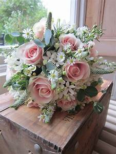 Pale pink ' sweet avalanche' roses with white bouvardia