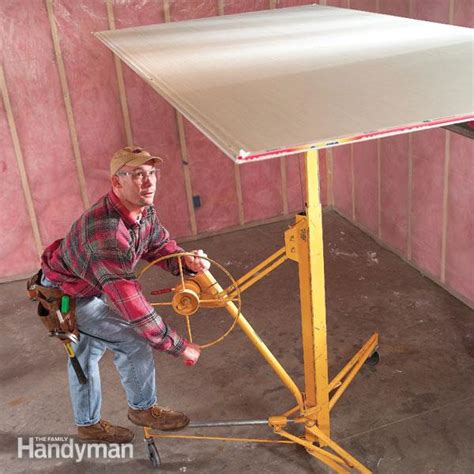 Hanging Drywall On Ceiling Tips by How To Hang Drywall Use A Lift The Family Handyman