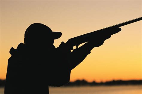 Silhouette Of Hunter And Gun Photograph by J&L Images
