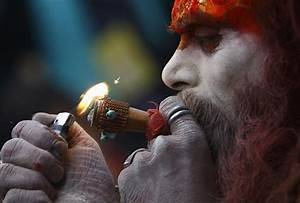 "The ""sadhus"" mark the festival by praying, meditating ..."