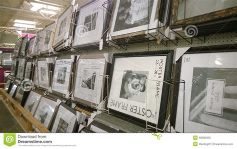 picture frames on shelves selling editorial stock image