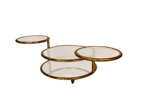Born in kansas in 1923, milo baughman was an incredibly prolific designer, lecturer, and author, whose aesthetic sensibility helped to define the midcentury modern style in the baughman spent his formative years in long beach, california. Milo Baughman style Mid Century Four Tier Brass Glass Swivel Coffee Table