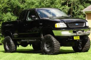 Jacked Up Ford Trucks with Mud Tires