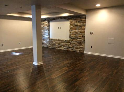 dark floors light grey walls and stone love my basement basement