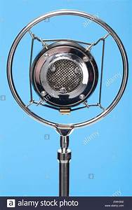 Vintage Microphone on a blue background Stock Photo ...