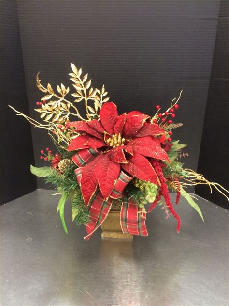 red poinsettia custom floral  andrea  michaels