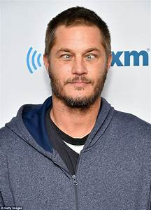 Travis Fimmel crosses eyes while posing for cameras as he ...