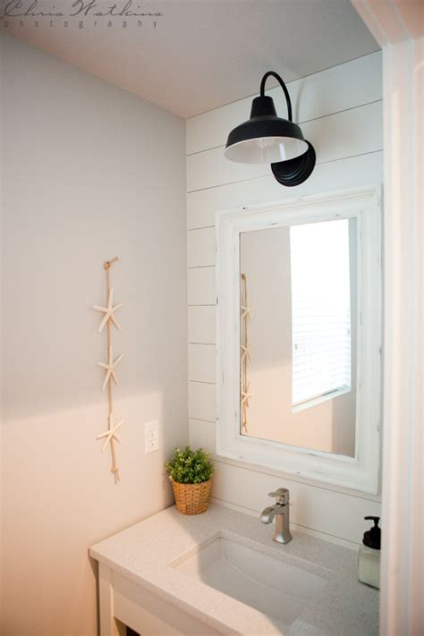 farmhouse bathroom lighting barn wall sconce lends farmhouse look to powder room Farmhouse Bathroom Lighting