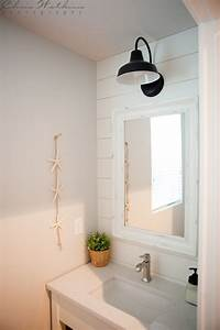 Barn wall sconce lends farmhouse look to powder room for Barn style vanity lights