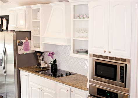 benjamin simply white kitchen cabinets herringbone subway tiles transitional kitchen 9100