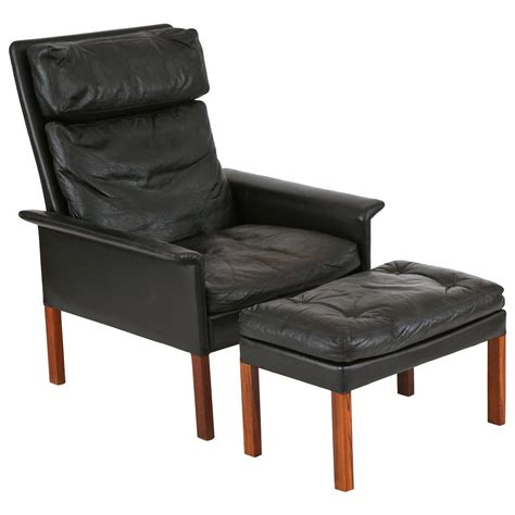 hans leather and rosewood lounge chair and ottoman