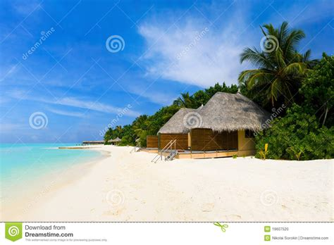 Tropical Beach And Bungalows Stock Photo