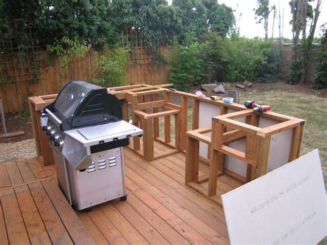 Building outdoor kitchen bbq having fun and saving