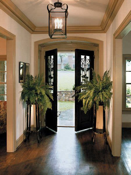 Small Entryway Lighting Ideas - beautiful antique doors opening into a simply