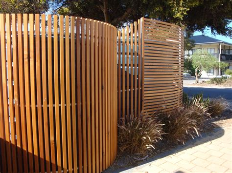 built  cedar screens  hide  rainwater tanks