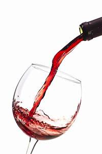 Red Wine Pouring Into Wineglass Splash Photograph by