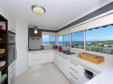 lights for cabinets in kitchen modern u shaped kitchen design using polished concrete 9695