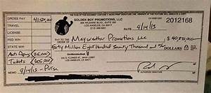 Look at Floyd Mayweather's 40 Million Dollar Check | Genius