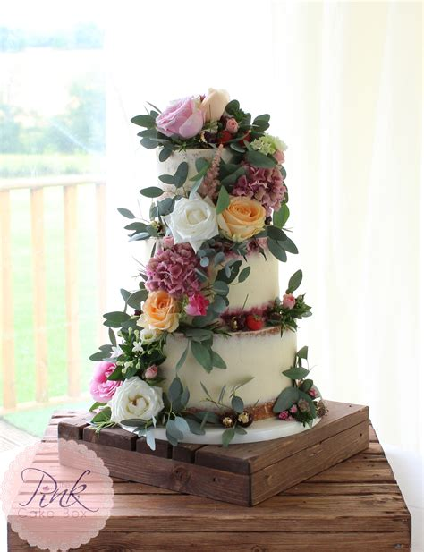 semi naked wedding cake  fresh flowers wedding cakes
