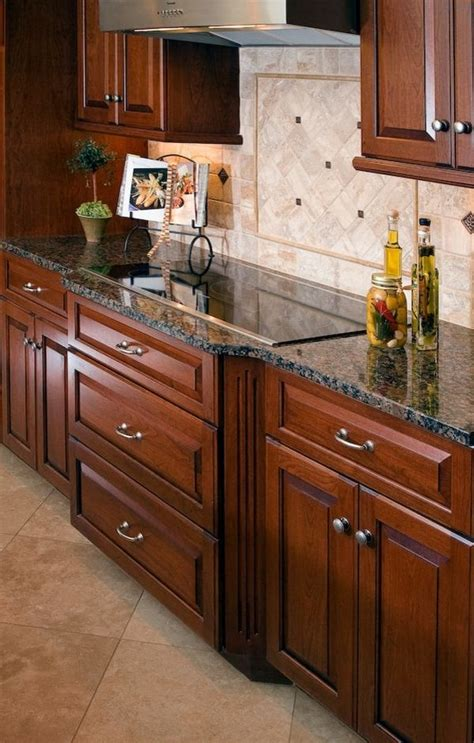 granite countertops with brown cabinets wood kitchen cabinets baltic brown granite countertop tile