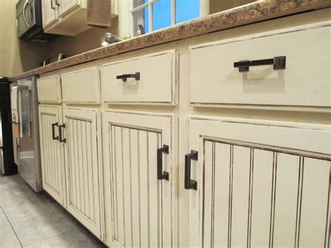 They redid these cabinets and distressed them. They are