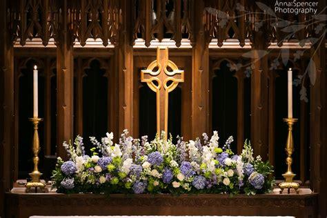 purple  white altar flower wedding arrangement
