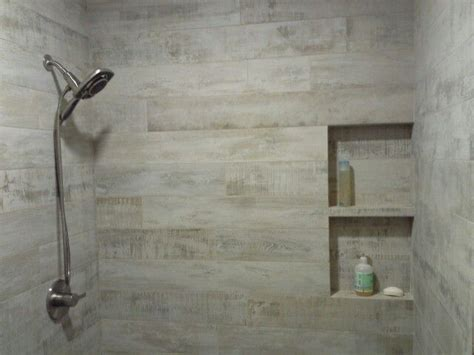 porcelain wood planks  shower wniche   tile